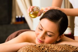 33752429 - chinese asian woman in wellness beauty spa having aroma therapy massage with essential oil, looking relaxed